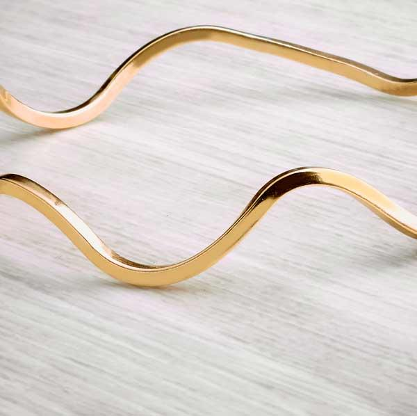 Wavy brass bangle by Alice Chandler Cop shot