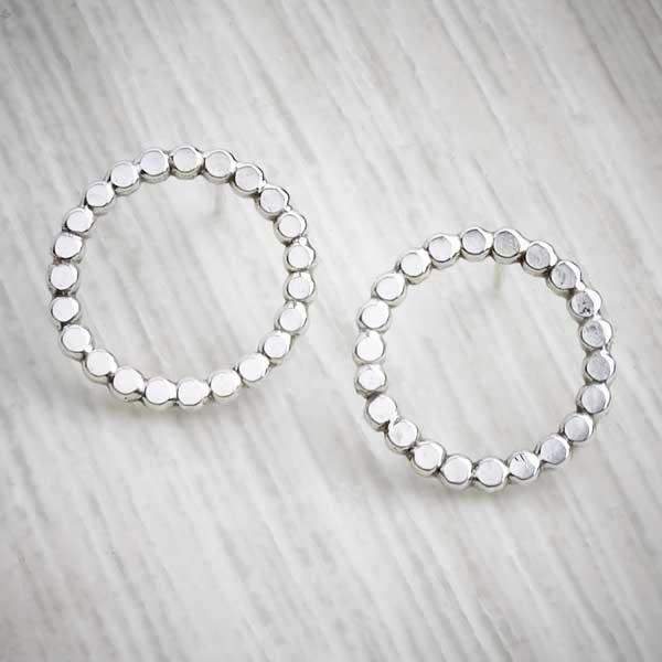 Silver handmade earrings, bobble circle studs on grey background