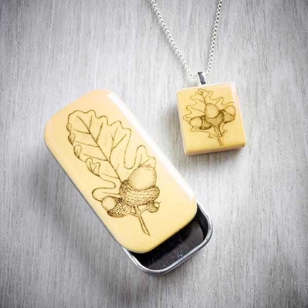 Acorn Scrabble Tile Pendant and Tiny Tin by Leigh Shepherd. Image property of THE JEWELLERY MAKERS.