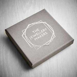 A grey box for jewellery with a stylish silver logo