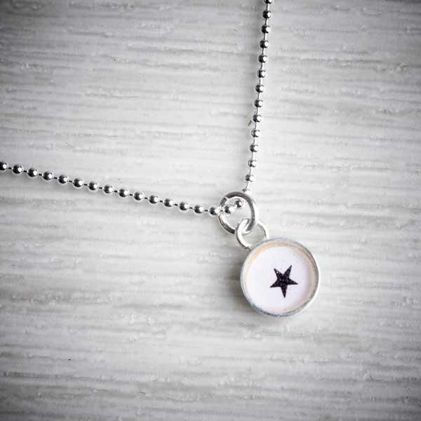 Tiny Silver & Resin Star Charm Pendant by Clare Collinson. Image property of THE JEWELLERY MAKERS.