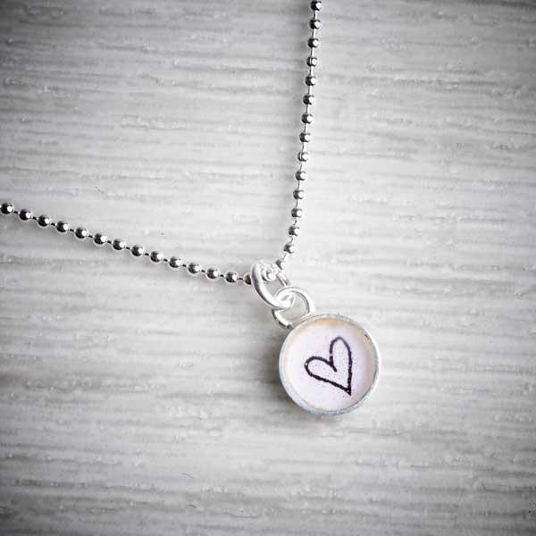Tiny Silver & Resin Heart Charm Pendant by Clare Collinson. Image property of THE JEWELLERY MAKERS