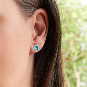 Halo Midi Stud enamel earrings in Aqua by Kokkino, worn on