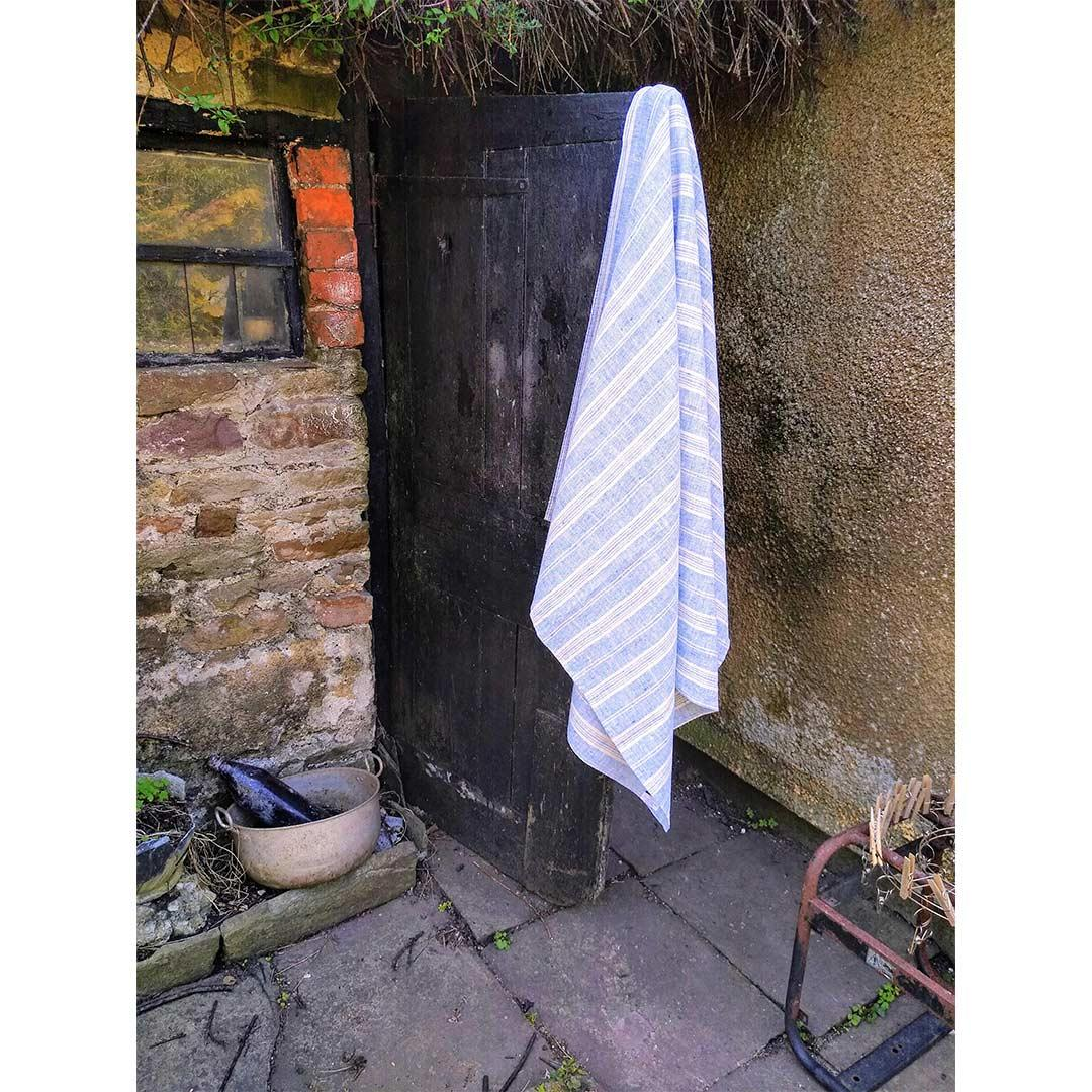 100% Linen Beach/Bath Towel -  Multistripe - Blue/White hanging on door