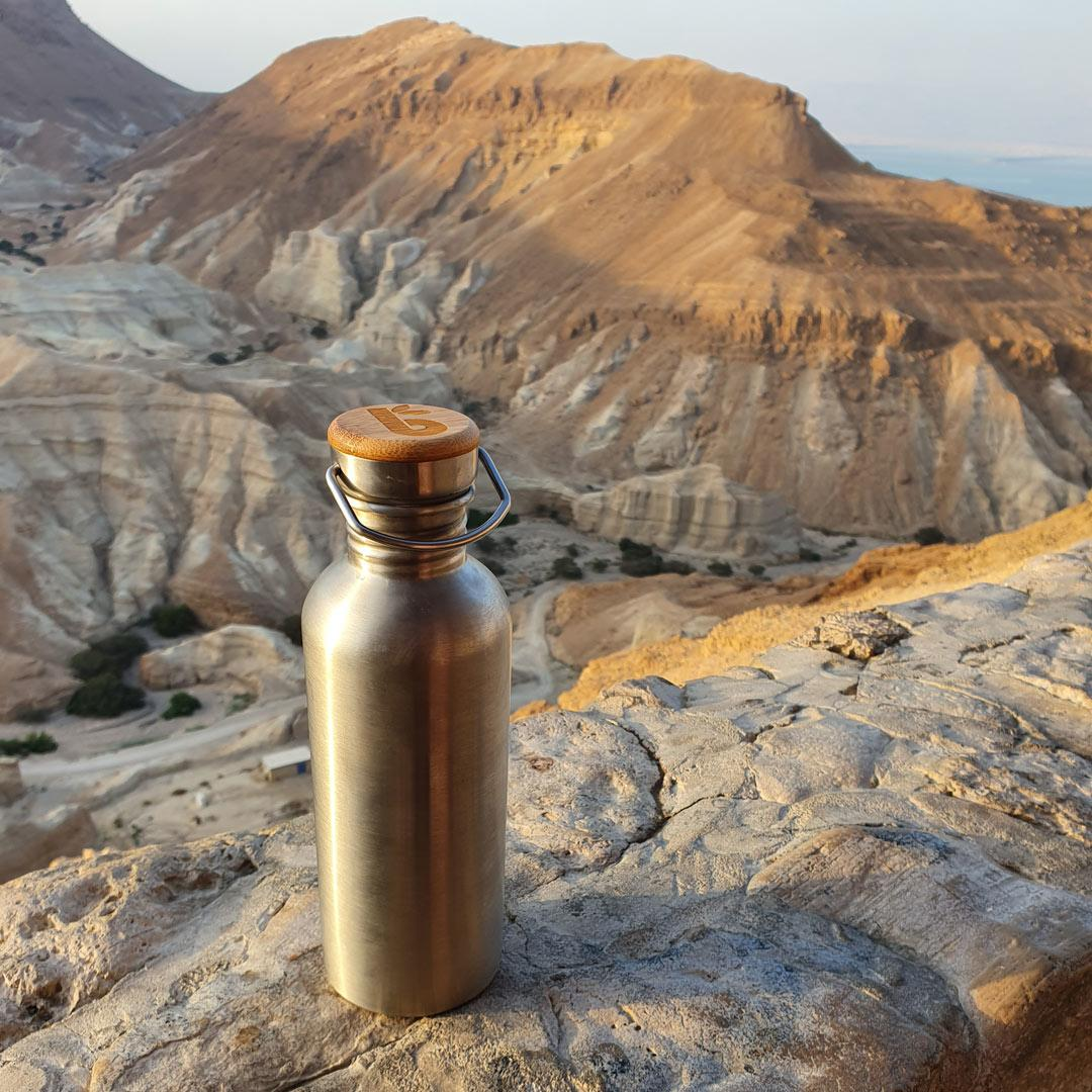 1 Litre Stainless Steel Water Bottle - Bambaw in backpack