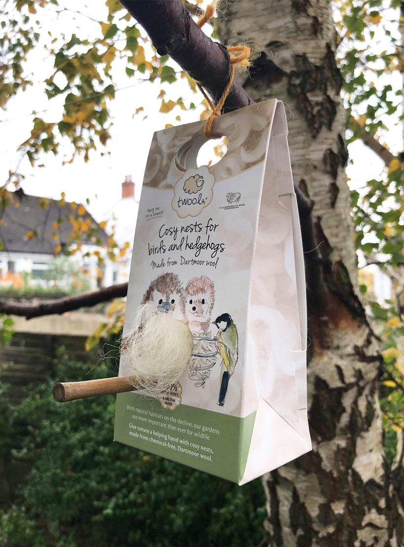 Cosy Nests for Birds and Hedgehogs - box hanging in tree