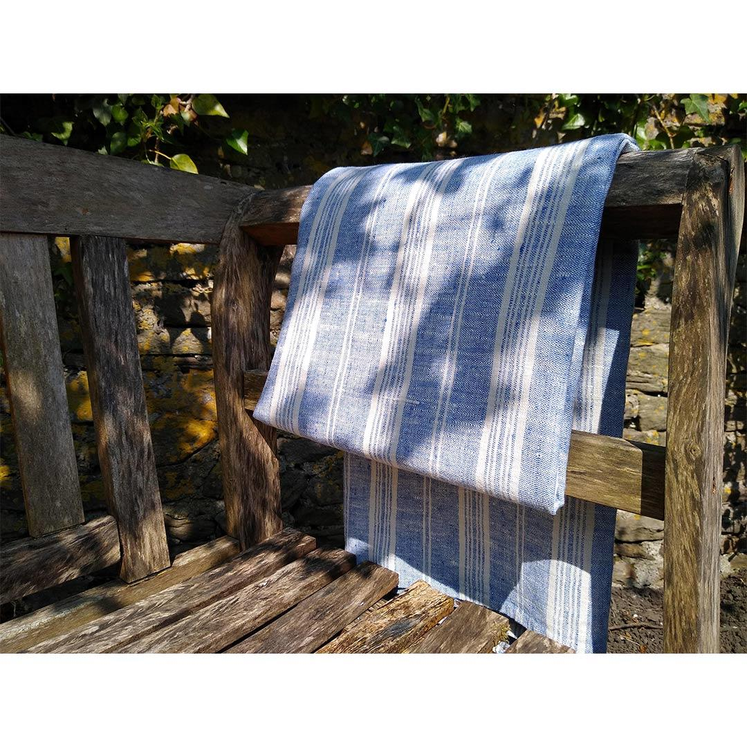 100% Linen Beach/Bath Towel -  Multistripe - Blue/White on bench