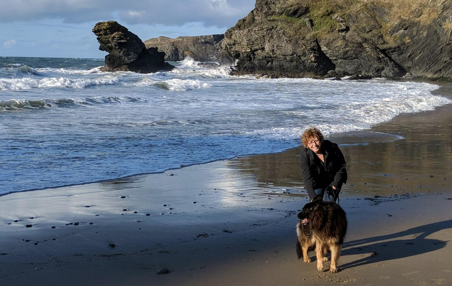 Founder Cath with her dog on the beach