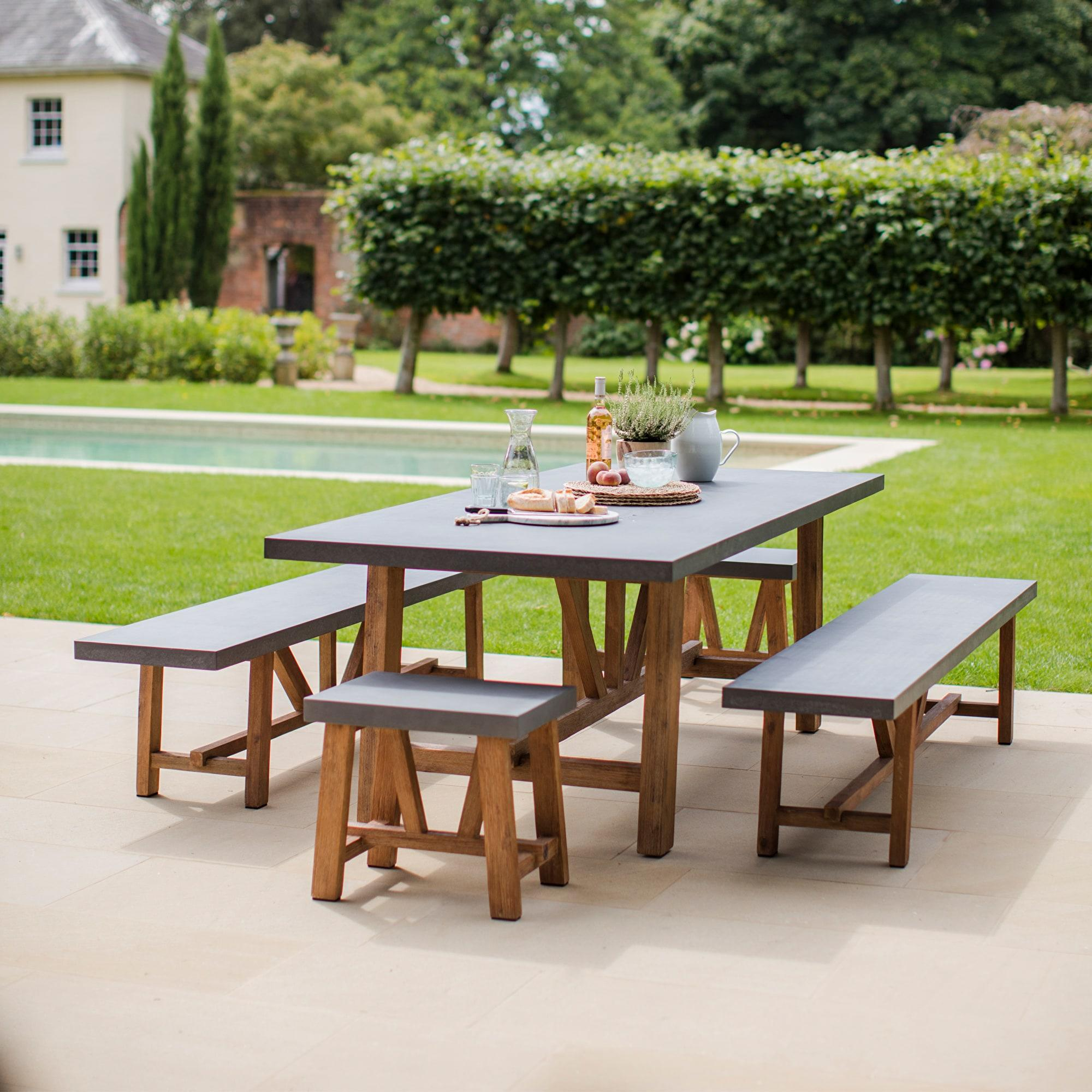 garden table with cement fibre and hardwood benches and stools