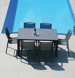 grey metal garden dining table in grey aluminium with grey textilene sling dining chairs 6 seater