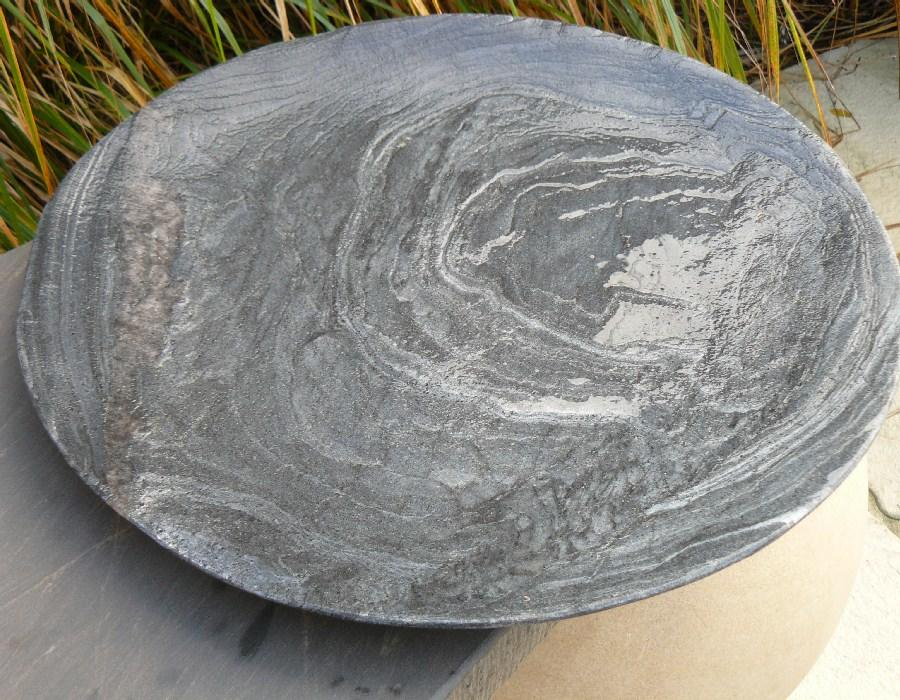 grey slate bird bowl in garden