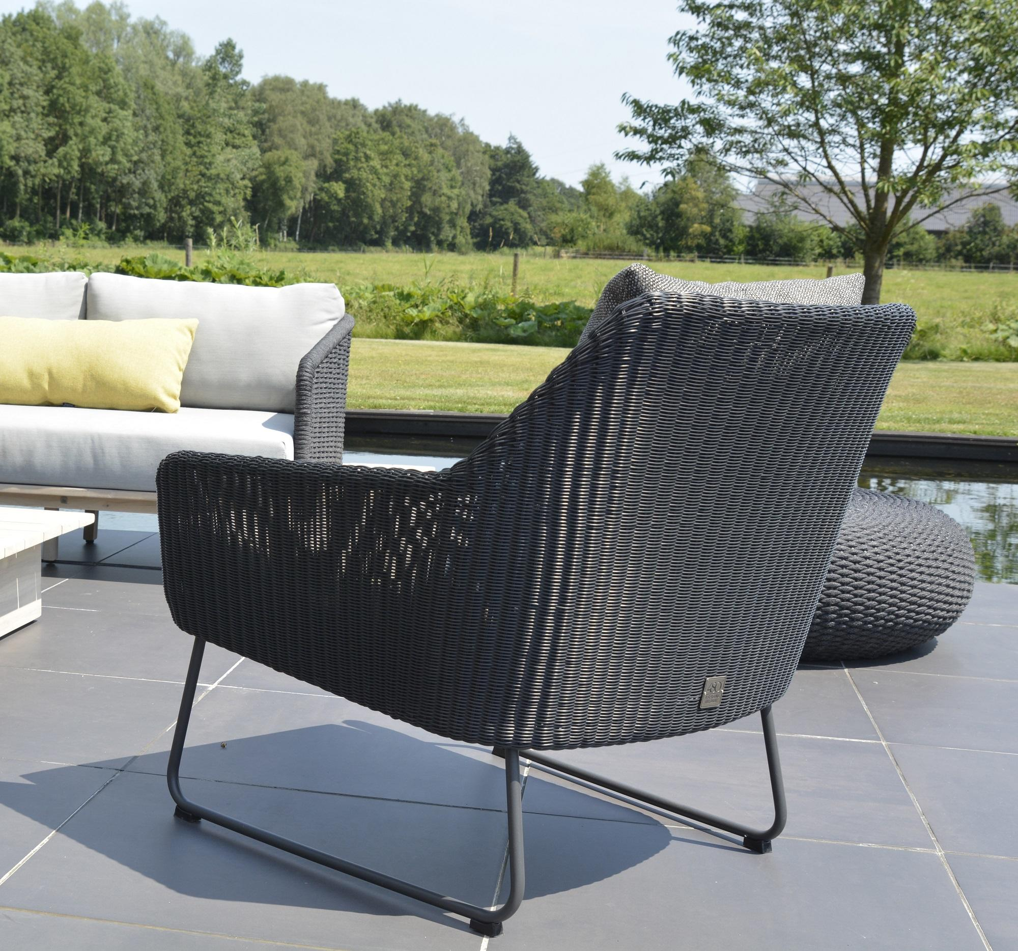 modern rattan garden armchair in all weather weave