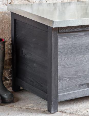 detail of outdoor storage box in black hardwood