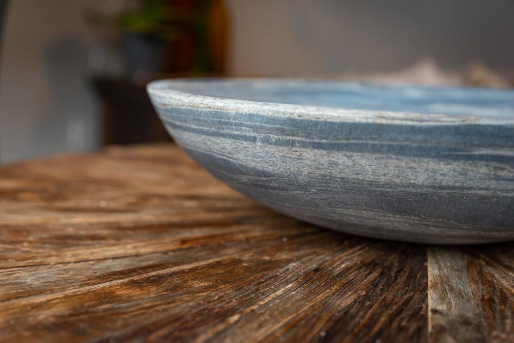 close up of veining on pewter sandstone bird bowl