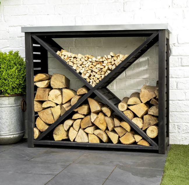 log storage in cross design for logs and kindling wood