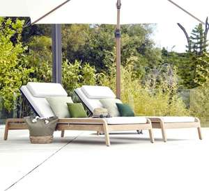 pair of high grade luxury teak sun loungers or sunbeds for gardens , pools, terraces with weatherproof cushions