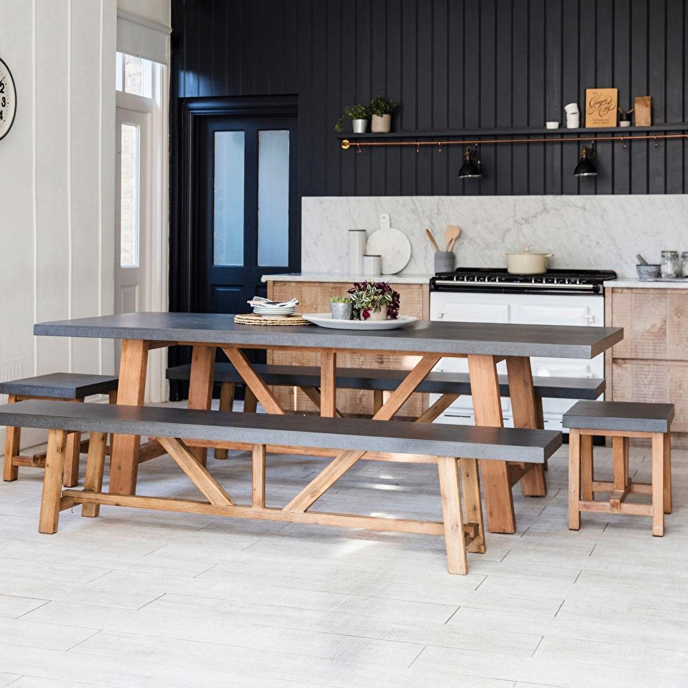 cement fibre and hardwood table and benches and stools in kitchen indoor setting
