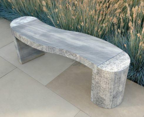 grey sandstone modern garden bench with curved design