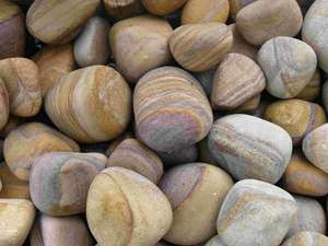 rainbow sandstone pebbles under water feature