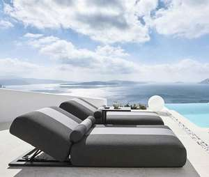 deep sun lounger daybed sunbed in grey weatherproof fabric by pool