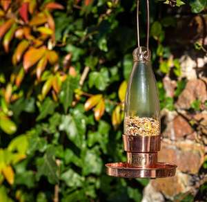 copper garden bird feeder with hand blown glass