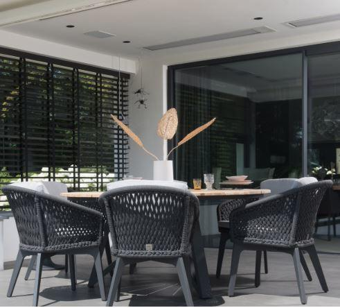 grey all weather rope garden dining chairs and round teak table