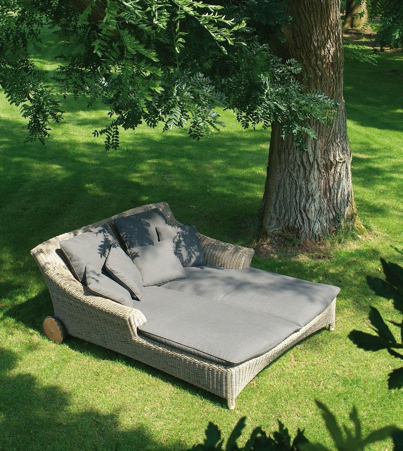 rattan garden or pool sun lounger or outdoor day bed