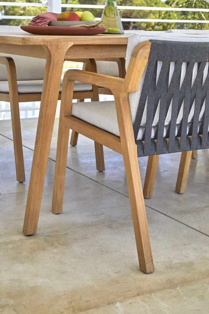 teak and strapping garden dining chair detail