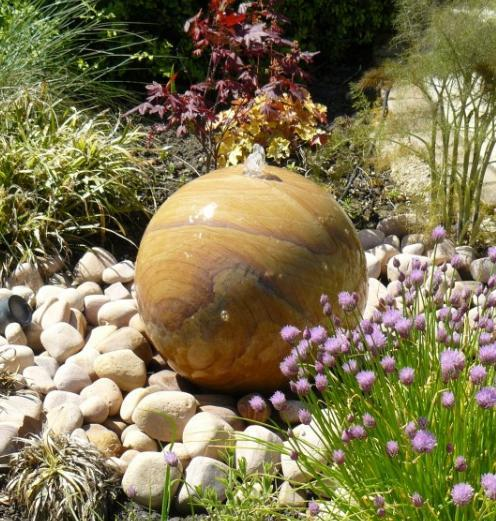 rainbow sandstone pebbles with water feature