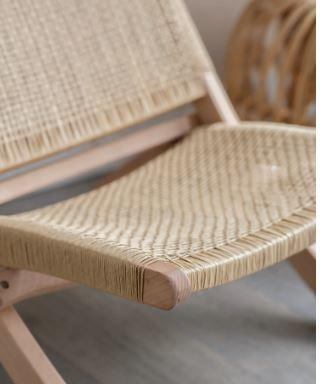 Closeup of intricate woven rattan chairs for indoor use