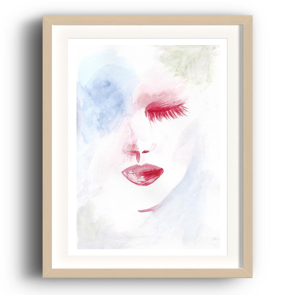 A watercolour print by Clarrie-Anne on eco fine art paper titled Dreaming showing a pale blue washed background with a red shut eyes and lips. IThe image is set in a beech coloured picture frame.