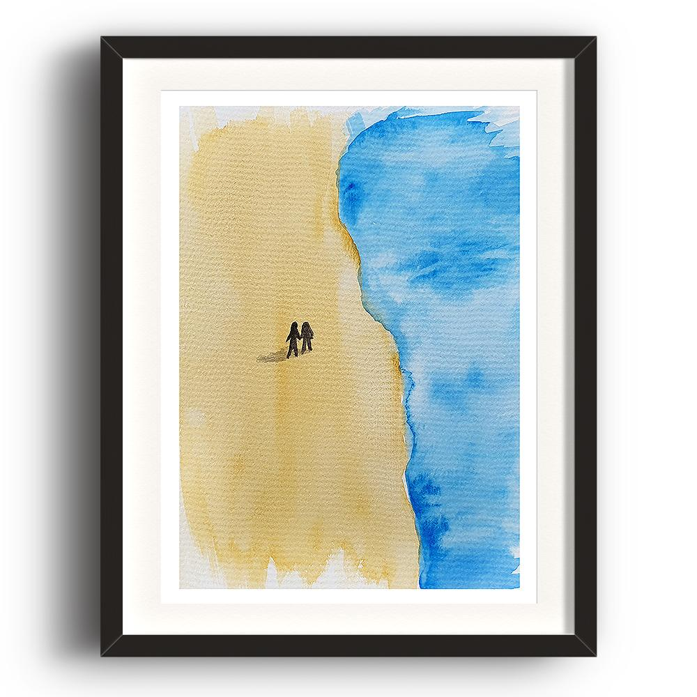 A watercolour print by Clarrie-Anne on eco fine art paper titled Take A Walk In Your Mind showing a deserted sandy beach from above with the sea approaching from the right and two small figures silhouetted alone on the beach holding hands. The image is set in a black coloured picture frame.