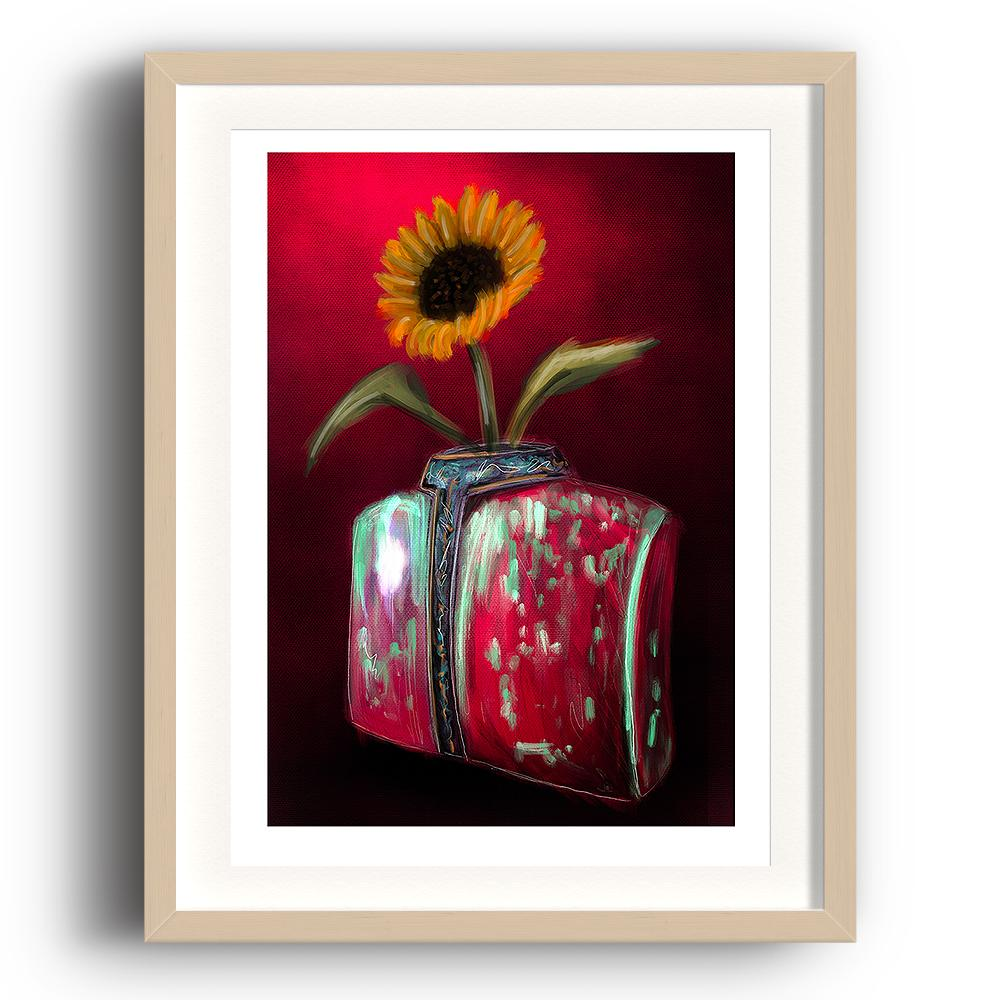 A digital painting by Lily Bourne printed on eco fine art paper titled Blooming showing a solitary sunflower in a torso shaped red and green coloured against a deep red wall. The image is set in a beech coloured picture frame.