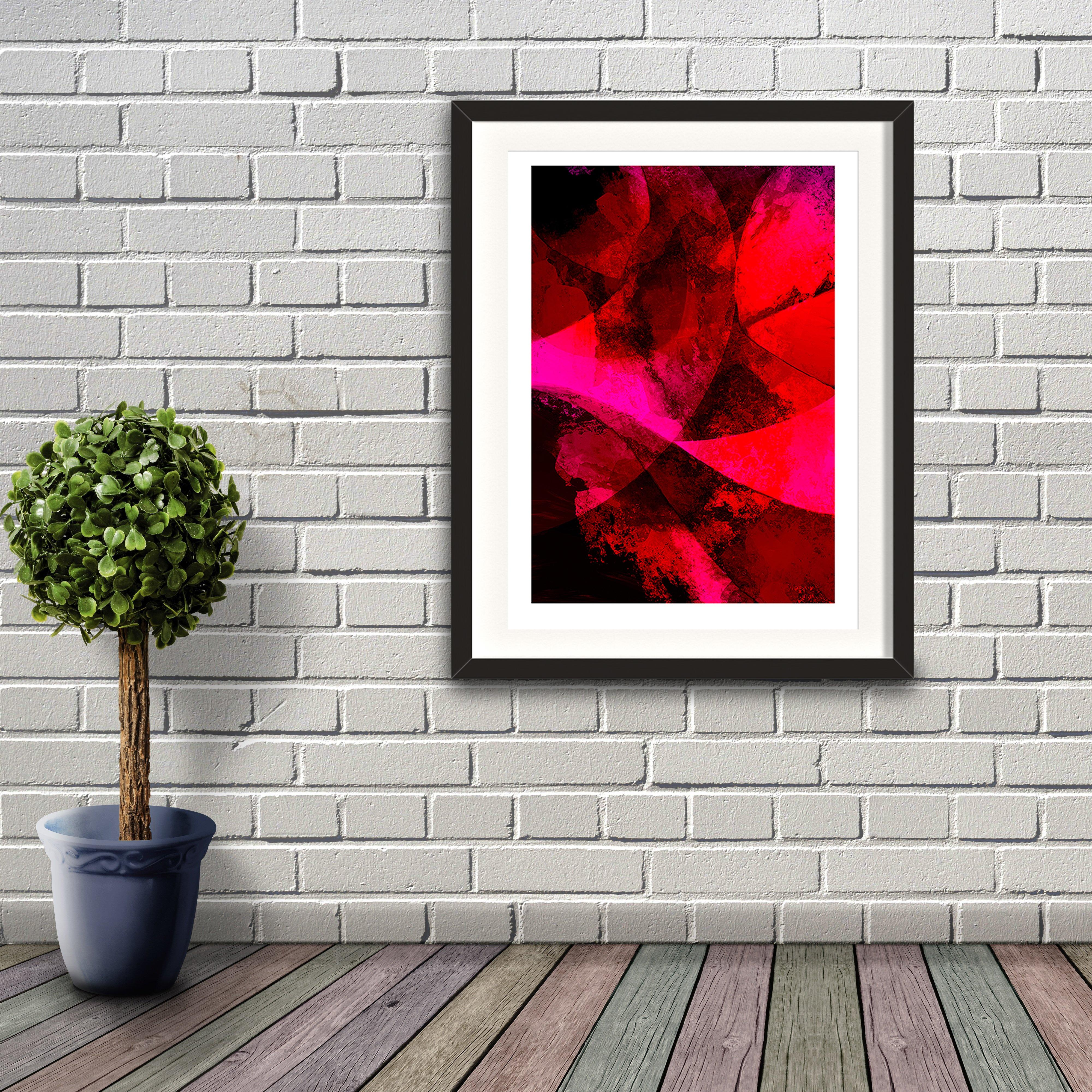 A digital painting by Lily Bourne printed on eco fine art paper titled Red Passion From Within showing a series of curved lines and textures colour red, bright pink and black. Artwork shown framed on a brickwall.