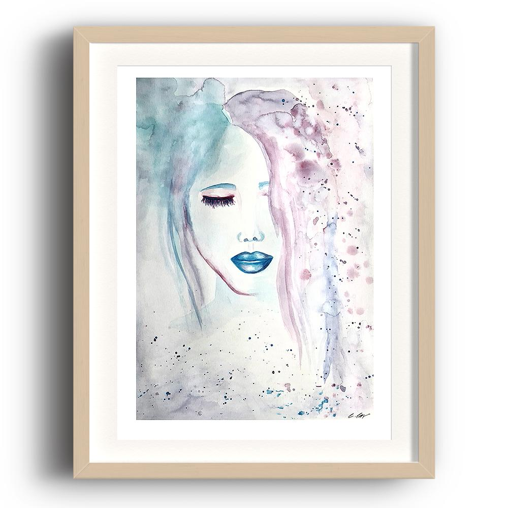 A limited edition watercolour print by Clarrie-Anne on eco fine art paper titled Compassion showing a female face, eyes shut with blue lips. The image is set in a beech coloured picture frame.