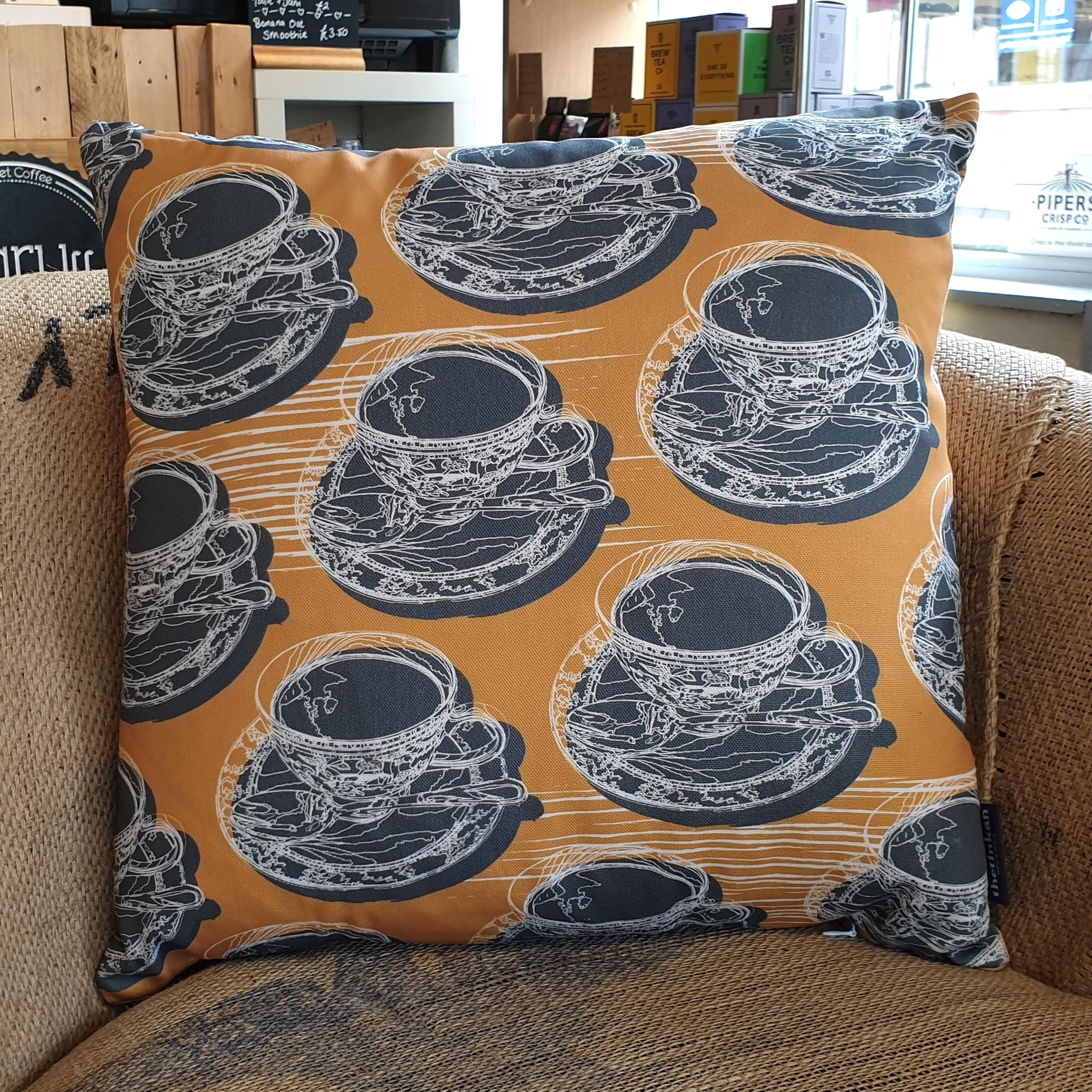 Double-sided mustard yellow 45cm square retro Afternoon Tea cushion with artistic white shards designed by thetinkan. White traced outline of multiple British teacups and saucers each colour filled in charcoal grey. Available with an optional luxury cushion inner pad. VIEW PRODUCT >>