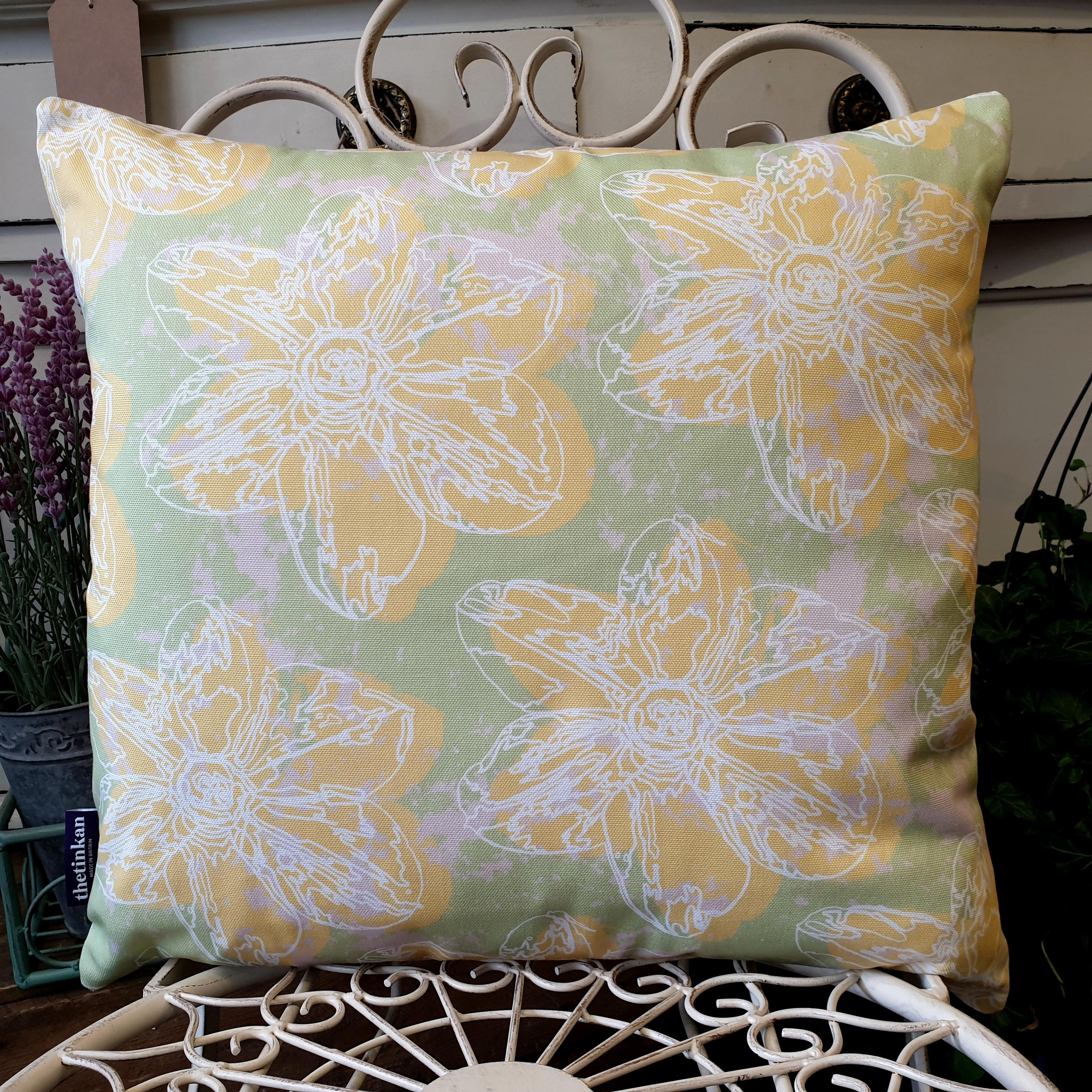 Double-sided 45cm square Flower Splash cushion designed by thetinkan. Yellow narcissus flower with white traced outline set within a mint green background with pale pink paint splashes. Available with an optional luxury cushion inner pad. VIEW PRODUCT >>