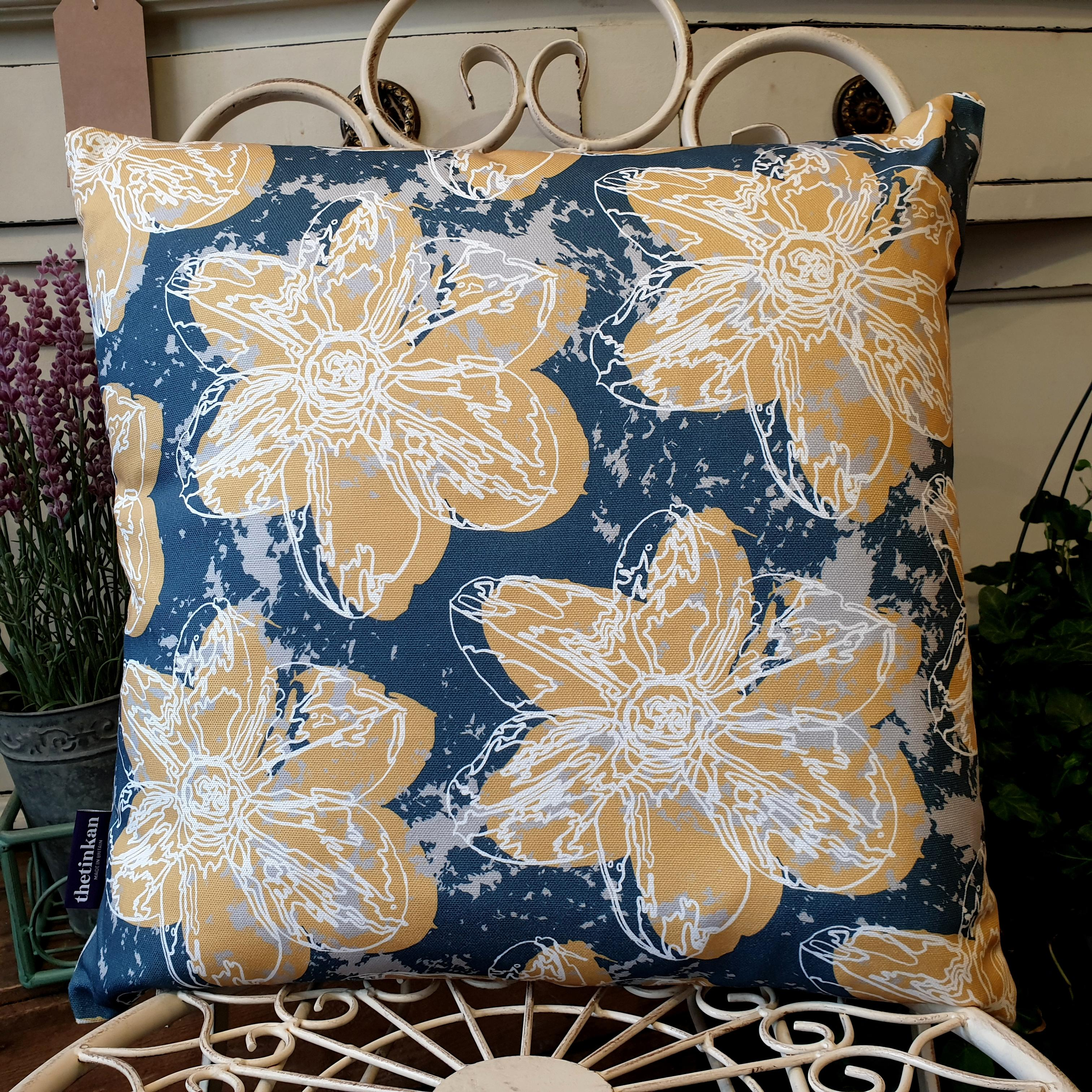 Double-sided 45cm square Flower Splash cushion designed by thetinkan. Mustard yellow narcissus flower with white traced outline set within an oxford blue background with pale grey paint splashes. Available with an optional luxury cushion inner pad. VIEW PRODUCT >>