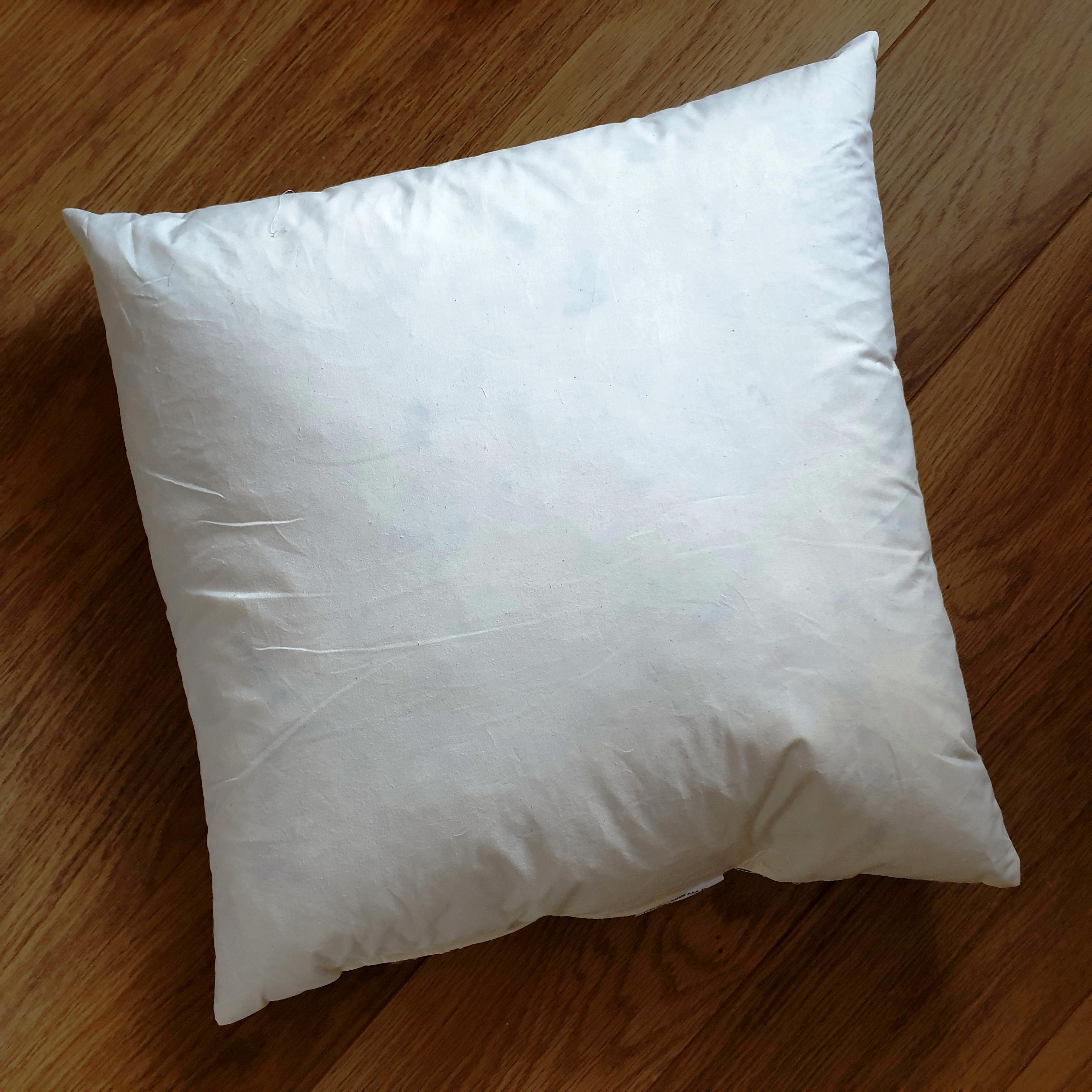 55cm cushion inner pad generously filled with 85% white duck feathers and 15% duck down in ecru cream 100% cotton outer cover.