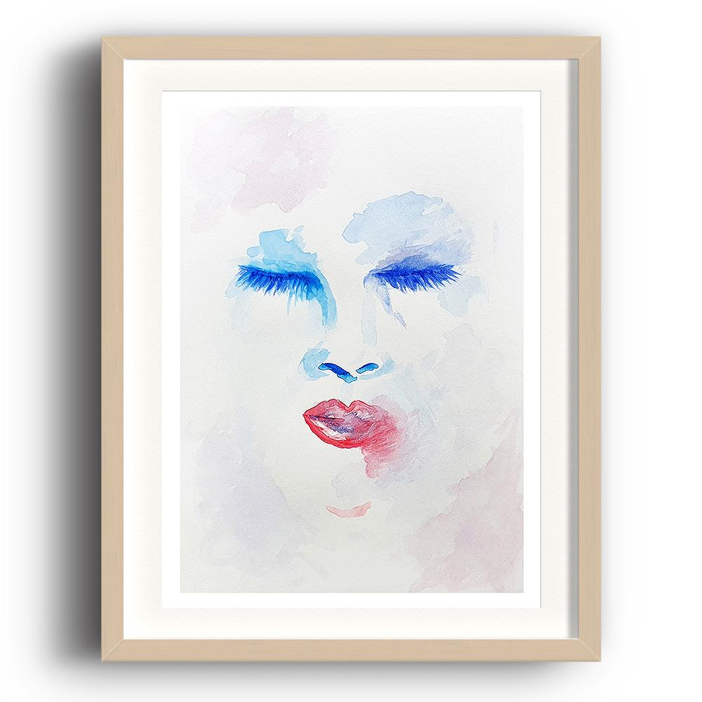 A watercolour print by Clarrie-Anne on eco fine art paper titled Delusion showing a red and blue outlined female face with eyes and lips on a atercolour wash background. The image is set in a beech coloured picture frame.