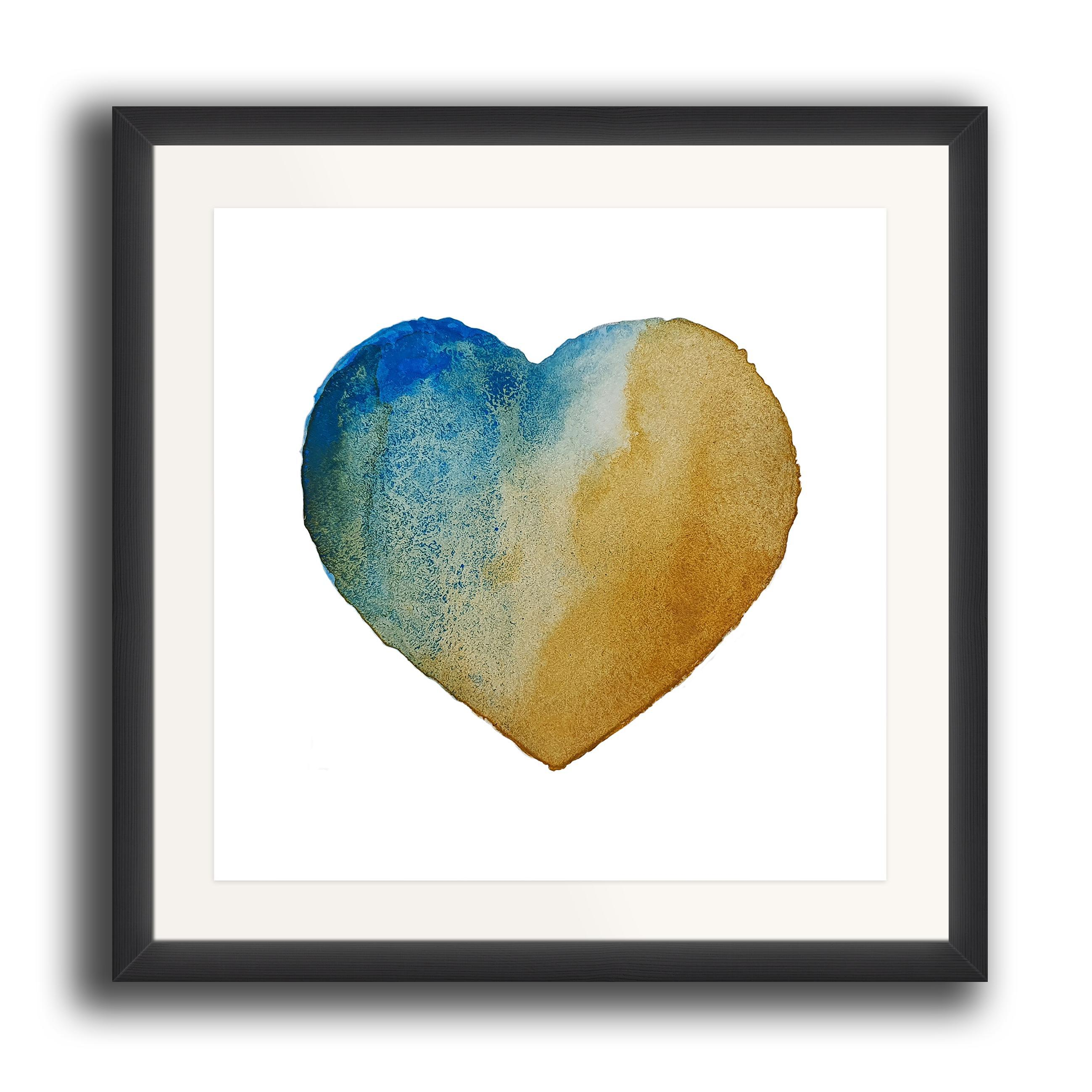 A watercolour print by Clarrie-Anne on eco fine art paper titled Beach Heart showing a textured turquoise golden sand coloured heart on a white background. The image is set in a black coloured picture frame.