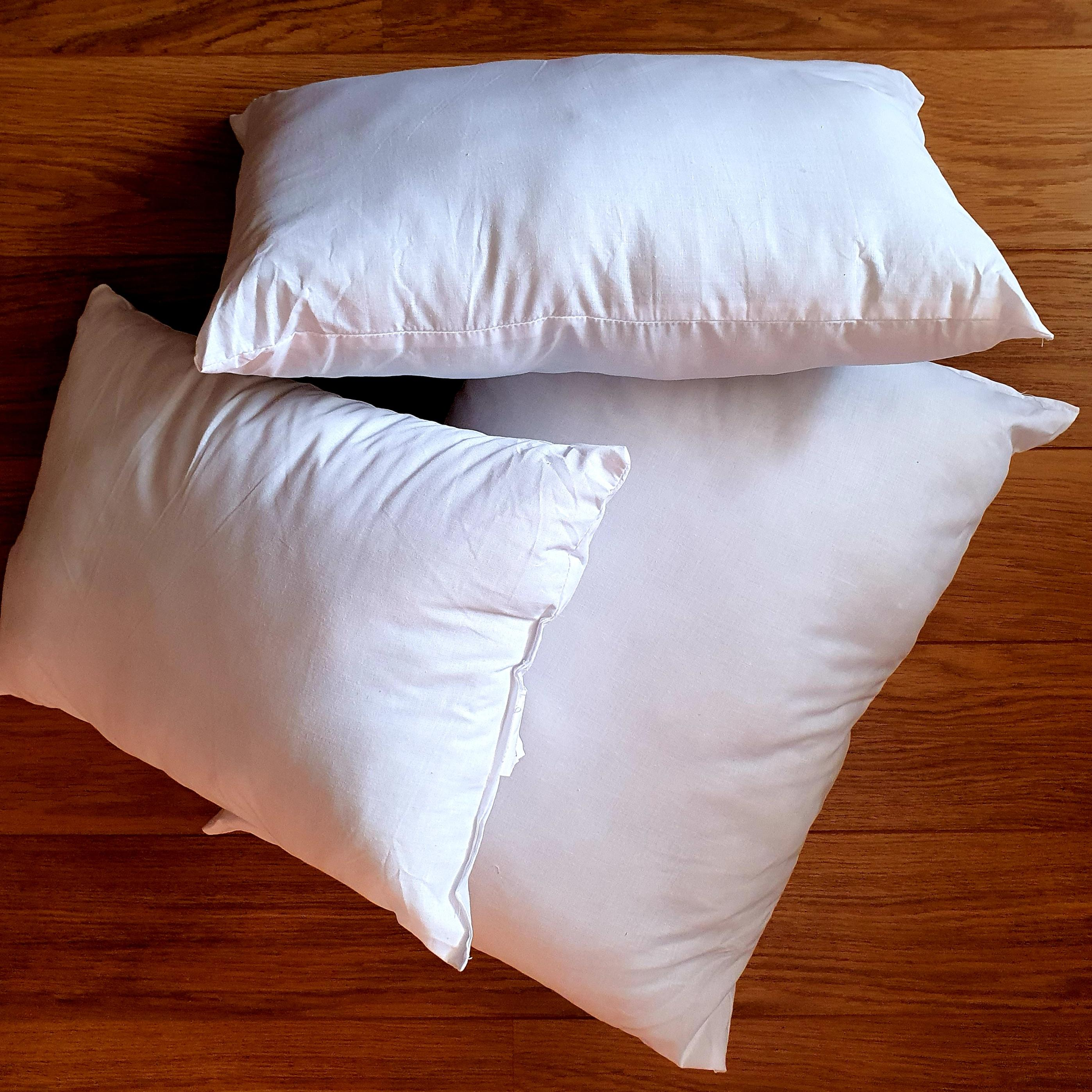 Group shot of cushion inner pads generously filled with Eco-Hollowfibre made from recycled plastic bottles in white poly cotton outer cover.