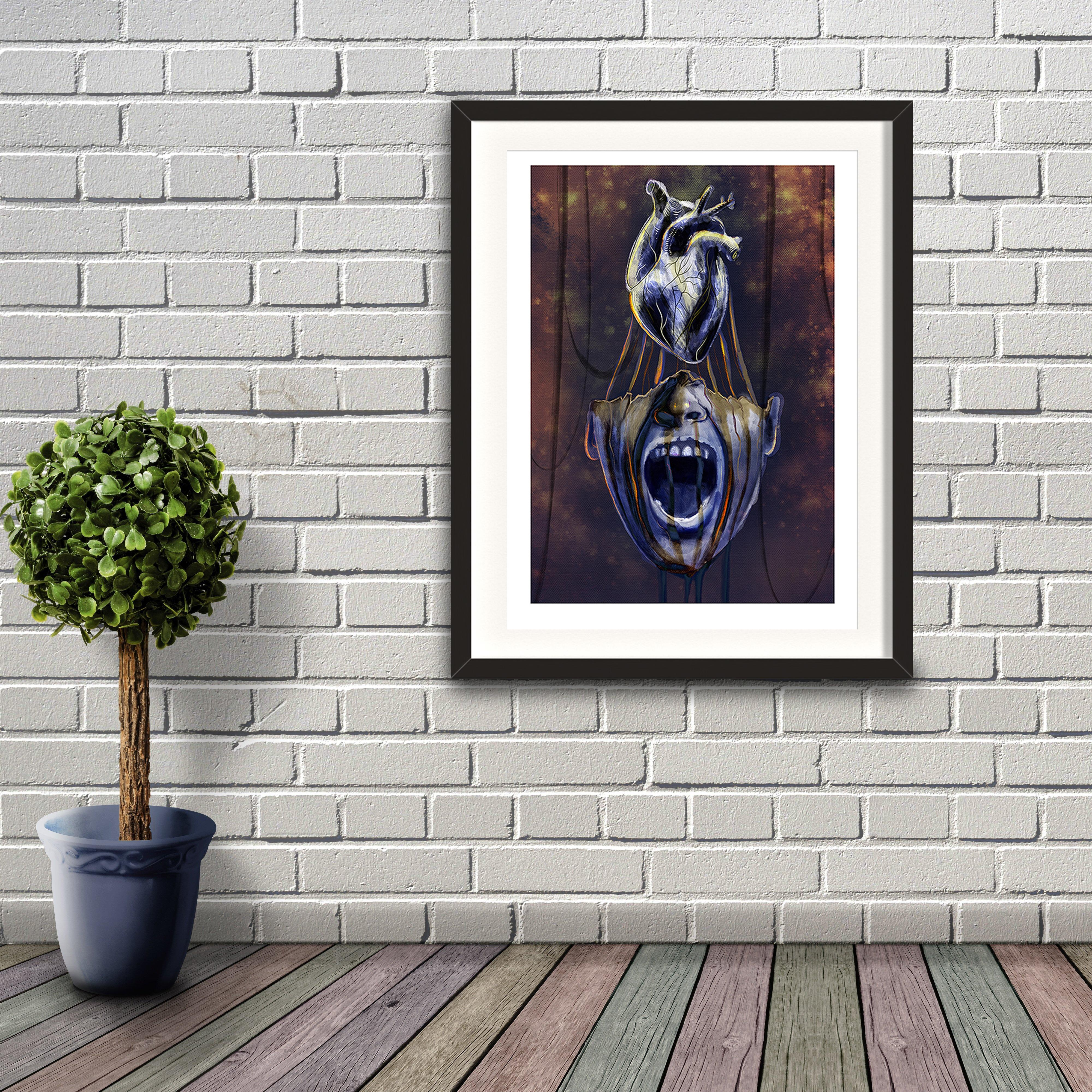 A digital painting by Lily Bourne printed on eco fine art paper titled Mind Of Midas showing an open mouth of King Midas with his heart above his head. Artwork is shown in a black frame hanging on a brick wall.
