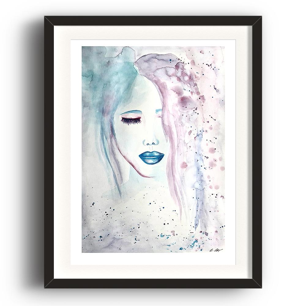 A limited edition watercolour print by Clarrie-Anne on eco fine art paper titled Compassion showing a female face, eyes shut with blue lips. The image is set in a black coloured picture frame.