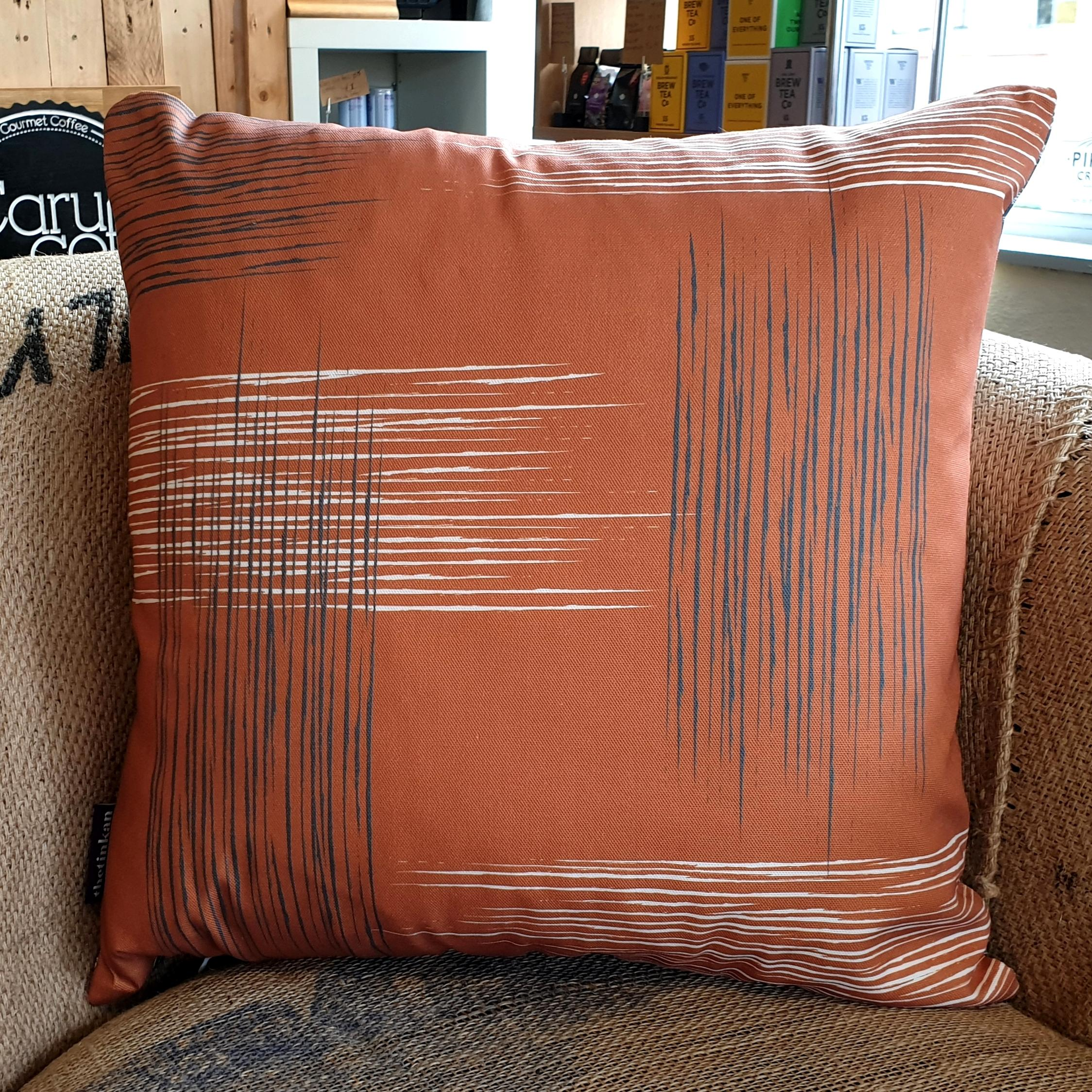 Double-sided warm rust orange 45cm square retro themed cushion with artistic grey and white shards designed by thetinkan. Available with an optional luxury cushion inner pad. VIEW PRODUCT >>