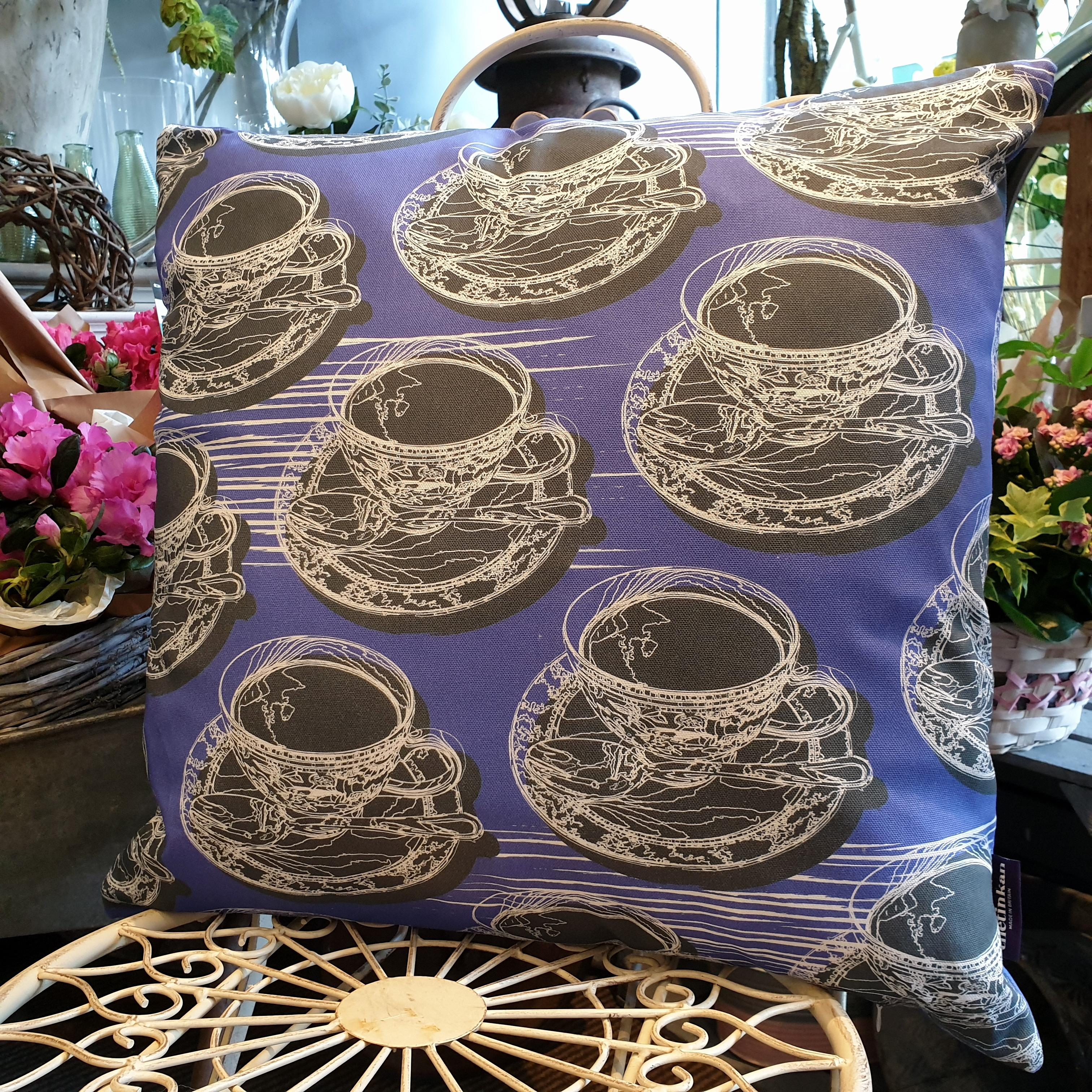 Double-sided violet purple 51cm square retro Afternoon Tea cushion with artistic white shards designed by thetinkan. White traced outline of multiple British teacups and saucers each colour filled in charcoal grey. Available with an optional luxury cushion inner pad. VIEW PRODUCT >>