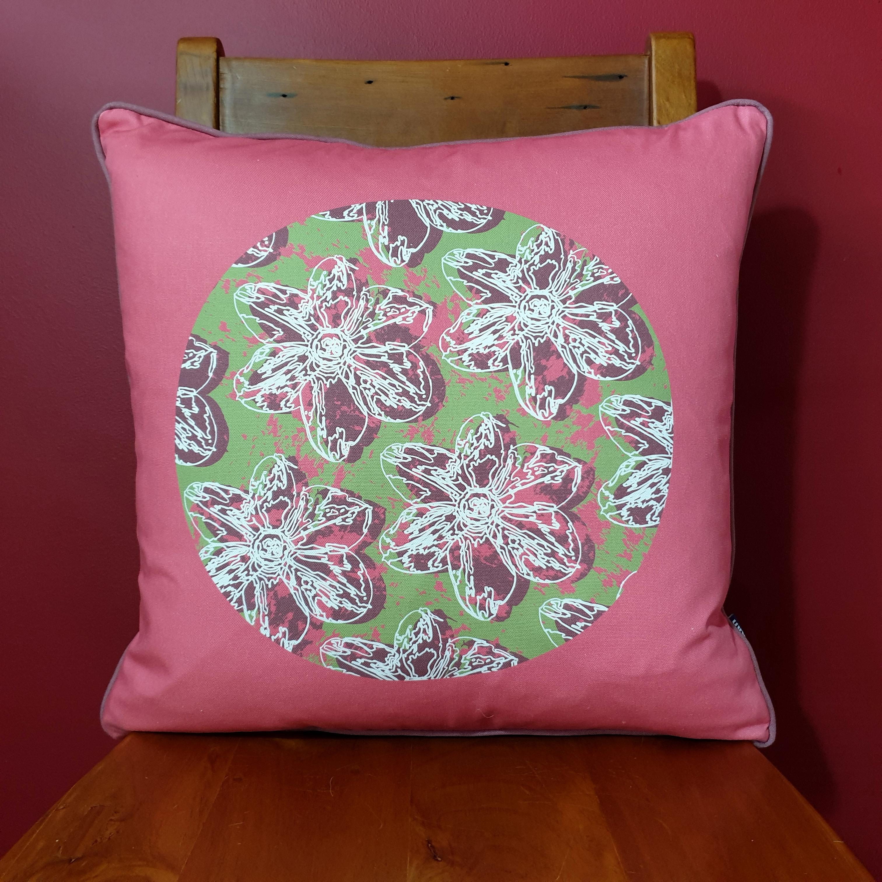 Double-sided 51cm square Flower Splash cushion designed by thetinkan. Dark Red narcissus flower with white traced outline set in an olive green coloured circle with salmon pink paint splashes and salmon pink surround. Available with an optional luxury cushion inner pad. VIEW PRODUCT >>