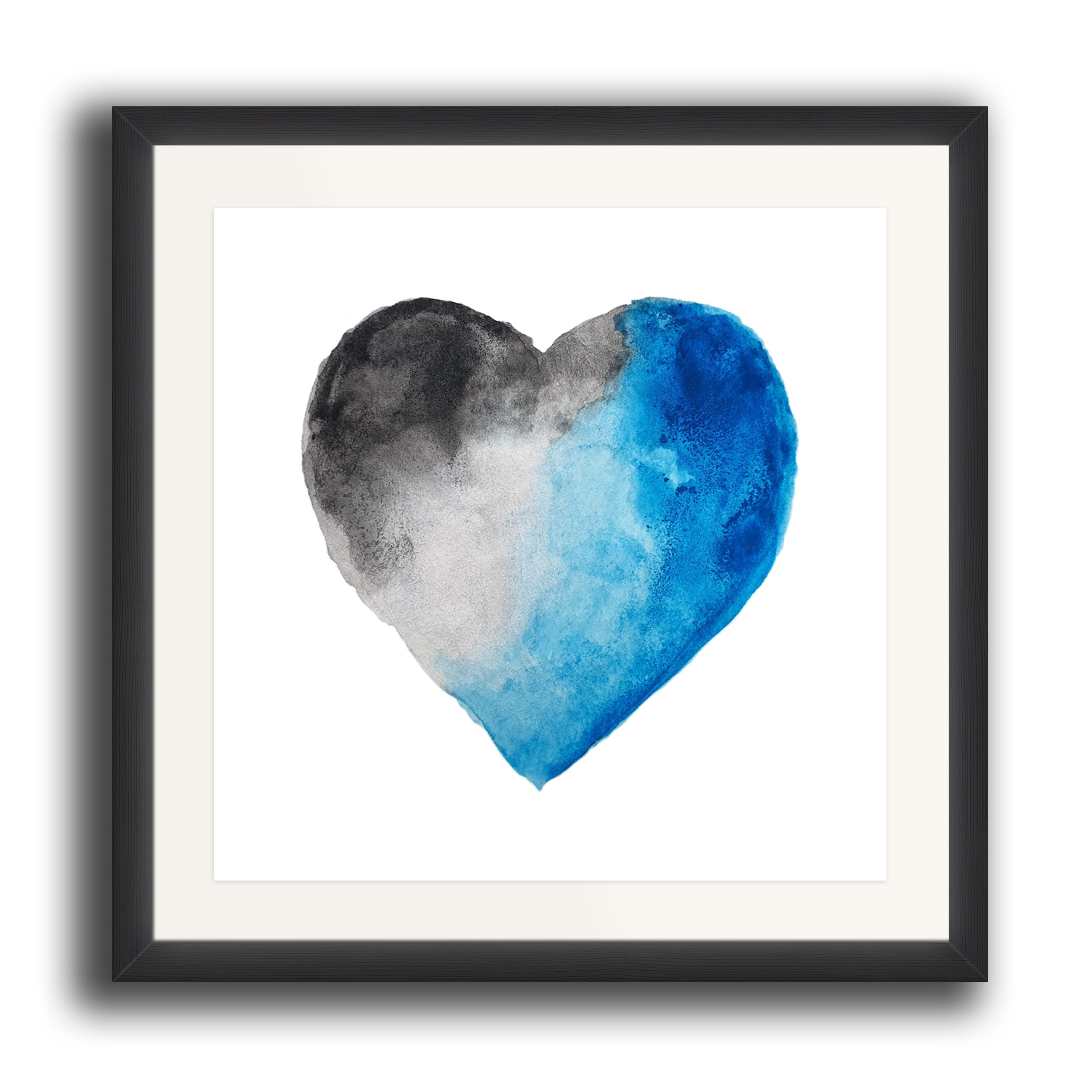 A watercolour print by Clarrie-Anne on eco fine art paper titled Thunder Heart showing a blue and greyscale watercolour heart on a white background. The image is set in a black coloured picture frame.