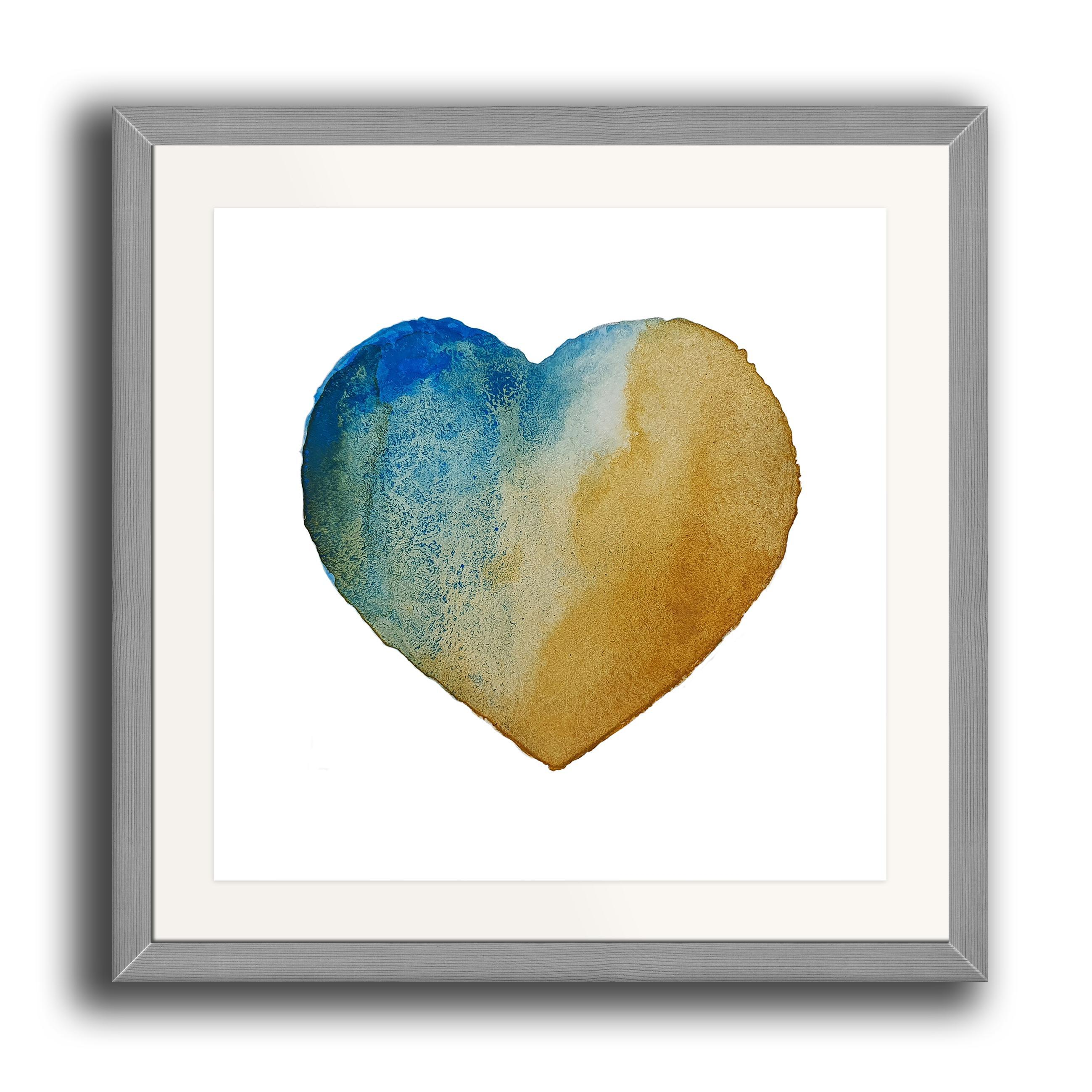 A watercolour print by Clarrie-Anne on eco fine art paper titled Beach Heart showing a textured turquoise golden sand coloured heart on a white background. The image is set in a beech coloured picture frame.