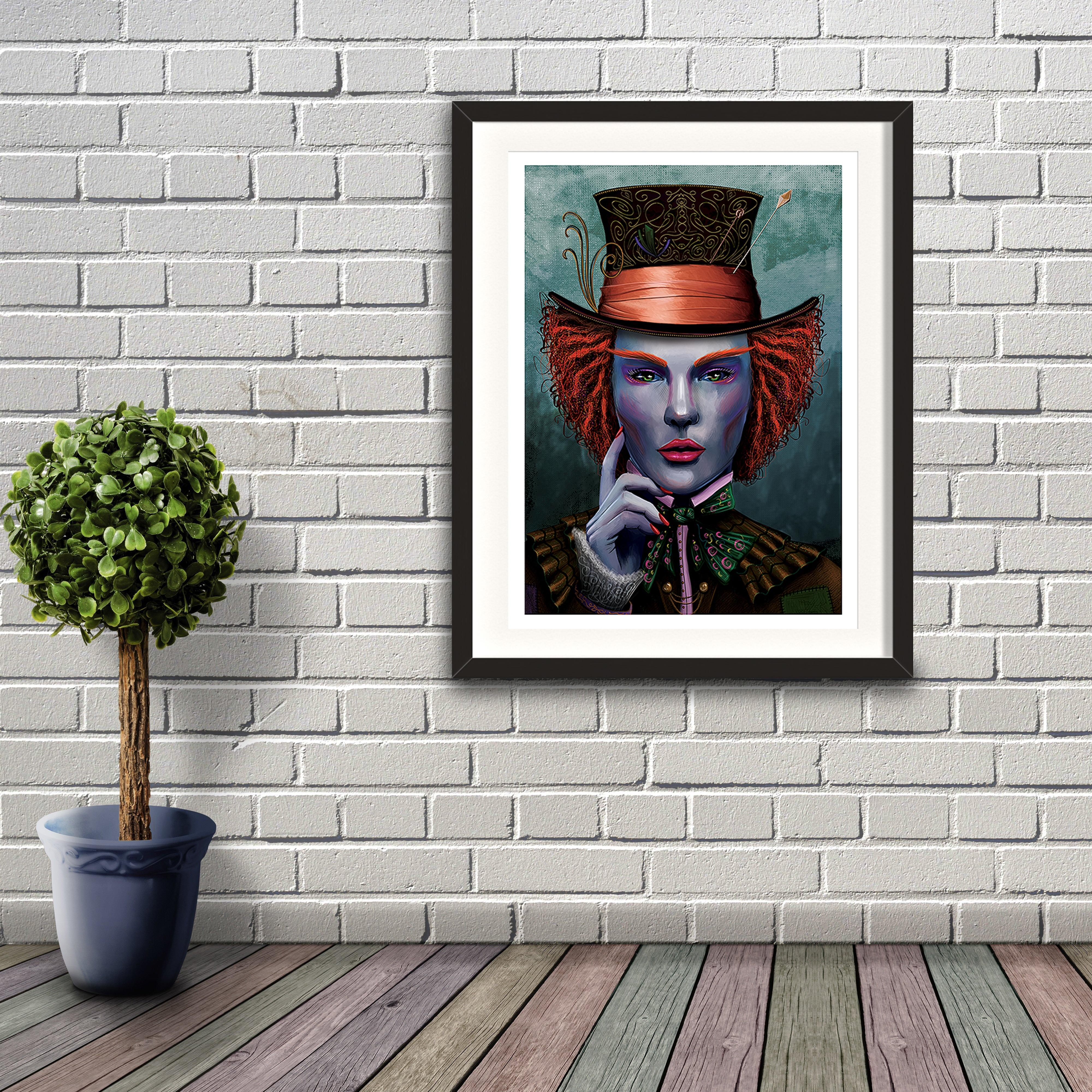 A digital painting called I Am by Lily Bourne showing face on portrait based on the character of The Mad Hatter with colourful hat and makeup. Artwork shown in a black frame on a brick wall.